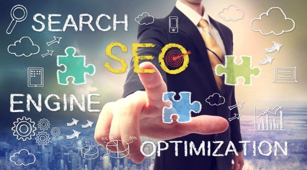 Businessman pointing SEO (search engine optimization)